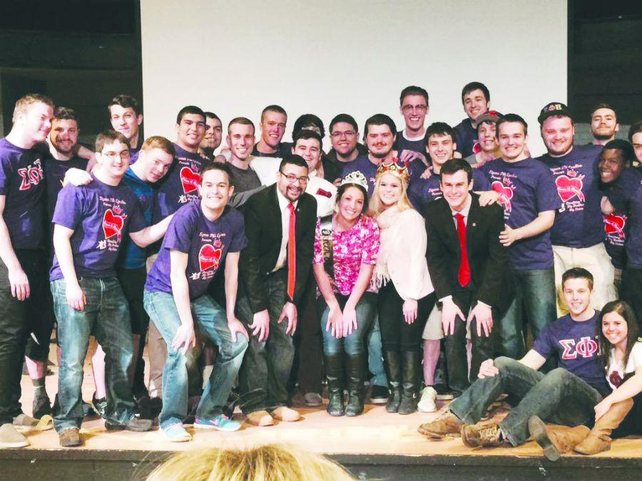 Brothers of Sigma Phi Epsilon fraternity with Queen of Hearts winner, Alison Fiorucci.