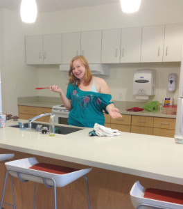 Junior Aileen Zietlow, a Resident Assistant for the building complex, in the kitchen of 63 Beech.