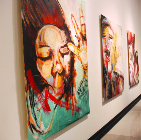 Wall of paintings in the exhibition by Cheyenne Richmond. Photo Credit: Cassandra Corridoni