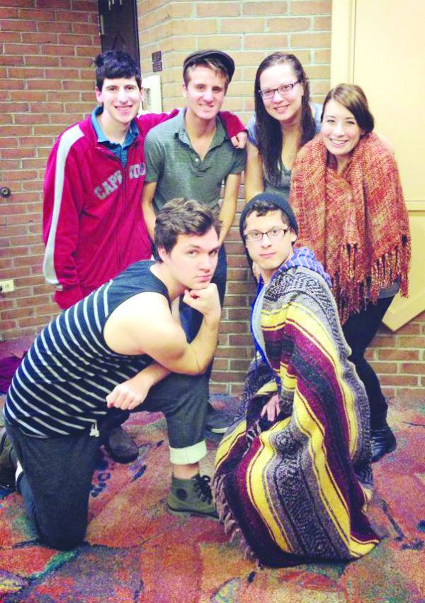The playwrights for the 24-Hour Theatre Project pose for a picture.