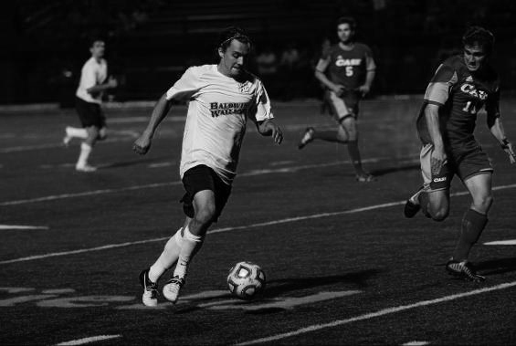 Senior Academic All-OAC midfielder Michael Brennan brings the ball down the field in BW's s victory against Capital University on their home Tressel Field inside The George Finnie Stadium.
