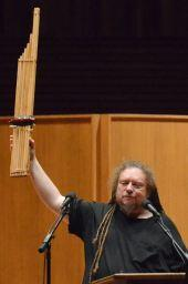 EQLS speaker, Jaron Lanier, holds up his khene, a traditional bamboo mouth organ from Laos. Lanier opened his presentation by playing this instrument that he compared to computers.