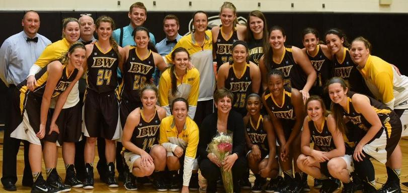 Coach Cheri Harrer and the rest of the women's basketball team celebrate coach Harrer's 500th win.
