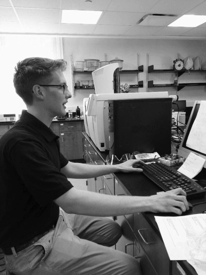 Chemistry major Aaron Hawke at work in a BW lab.