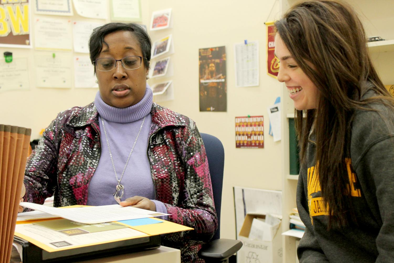 Erika Walker-Smith, assistant director of financial aid, discusses financial aid information with junior Britni Wolff. Based on changes at the federal level, incoming Baldwin Wallace students may have less options for financial aid.