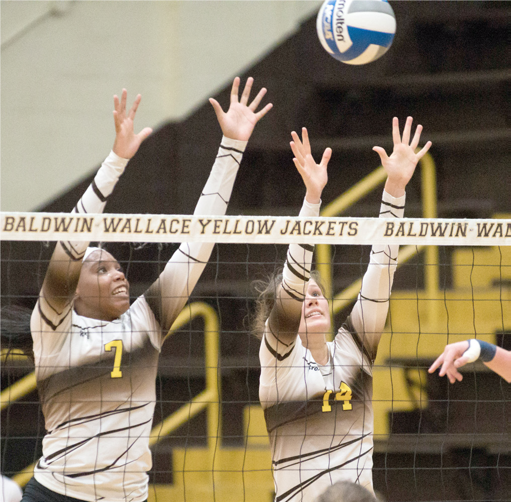 Taylor Brown, left, and Alicia Lortcher registered assisted blocks as the team swept Ohio Northern University last week.