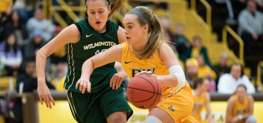 Baldwin Wallace guard Kasey Hughes drives during a recent game against Wilmington. She is third on the team in scoring, at 9.4 points per game. As a team, the Jackets are averaging 59 points against per game while scoring 70.
